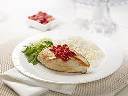 Garnishing chicken with cranberry chutney adds flavor and nutrients: Click here for full photo caption.
