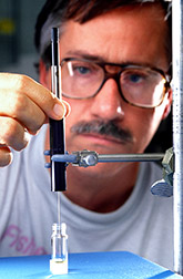 Entomologist David Robacker uses a solid-phase microextraction device. Click here for full photo caption.