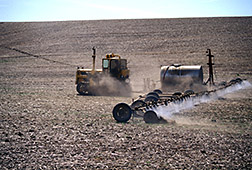 Herbicides are applied to a field to kill off weeds. Click here for full photo caption.