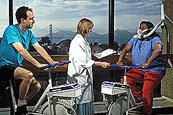 Nutrition researcher Nancy Keim monitors two volunteers during cycling exercise. Click here for full photo caption.