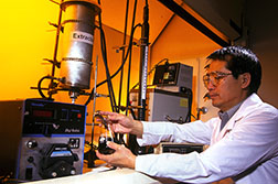 Chemical engineer Peter Wan takes a sample