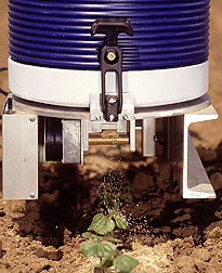 Tractor mounted Mite Meter dispenses up to 20,000 biocontrol mites per acre.