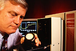 Chemist Franklin Barton uses a near-infrared reflectance spectrometer.