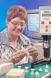 Chemist examines the fracture properties of cheese: Click here for full photo caption.