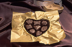 Photo: An open box of chocolates.