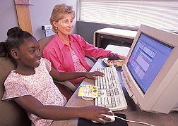 Clinical coordinator Jill Brackenbury explains a computerized diet-assessment program to a study participant. Click the image for additional information about it.