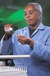 Chemist prepares water samples for nutrient analysis: Click here for full photo caption.