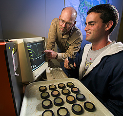 Ecologist and technician use near-infrared reflectance spectroscopy to develop databases: Click here for full photo caption.