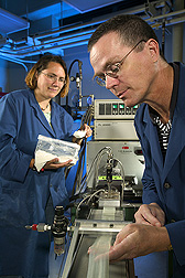 Research leader and chemist examine extruded electroactive bioplastic: Click here for full photo caption.