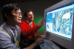 Computer programmer and agricultural engineer discuss the design of watershed model interface screens: Click here for full photo caption.
