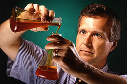 Chemist Kevin Hicks checks oil sample