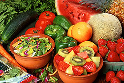 Photo: Fresh cut fruits and vegetables. Link to photo information