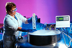 Technician examines seeds preserved in a vat of liquid nitrogen.