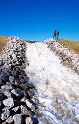 Rock chute safely transfers runoff to a lower elevation. Click here for full photo caption.