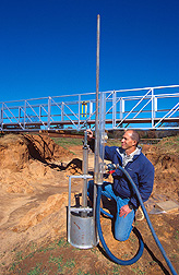 Hydraulic engineer conducts a jet test to evaluate soil erodibility. Click here for full photo caption.