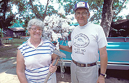 Cotton farmer and his wife: Click here for full photo caption.