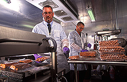 Molecular biologist and microbiologist vacuum-seal hotdogs: Click here for full photo caption.