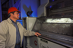 Textile technologist monitors the performance of a roller gin stand: Click here for full photo caption.