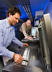 Brazilian geneticist (left) and ARS animal geneticist prepare to cryopreserve germplasm in a computerized programmable freezer: Click here for full photo caption.
