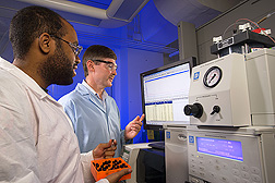 Technician (left) and plant physiologist analyze the pectic fragment composition of a prebiotic fraction from orange peel: Click here for full photo caption.