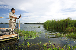 Soil scientist uses a probe to measure levels of salinity, dissolved oxygen, conductivity, and temperature in Spring Lake, in Brooksville, Florida: Click here for full photo caption.