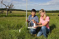 Soil scientist and technician take groundwater samples from a forage-based pasture in a cow-calf operation at the Subtropical Agricultural Research Station at Brooksville, Florida: Click here for full photo caption.