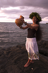 A ceremonial ipu is held by traditional dancer Kanoe Lake: Click here for photo caption.