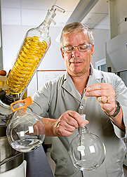 Photo: ARS chemist Mitchell Wise works with oat extracts in a glass vessel. Link to photo information