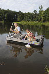 Agricultural Research Service scientists collect water samples in a pond in Watkinsville, Georgia: Click here for full photo caption.