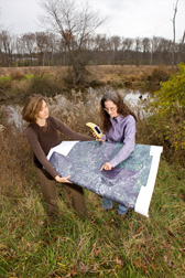National Aeronautics and Space Administration scientist (left) and USDA Forest Service ecologist use a global positioning system and a multispectral satellite image to investigate a riparian area in Beltsville, Maryland: Click here for full photo caption.