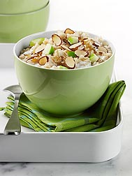 Sliced almonds add flavor, crunch, and nutrients to this serving of hearty apple-maple oatmeal: Click here for photo caption.