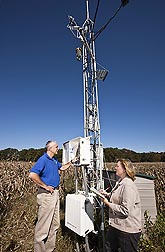 Research leader Bill Kustas and physical scientist Martha Anderson check measurements from a micrometeorological station located at the OPE3 field research site in Beltsville, Maryland: Click here for photo caption.
