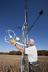 Hydrologist Bill Kustas checks the position of a water vapor/CO2 sensor on a micrometeorological tower: Click here for full photo caption.