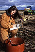 Technician Amy Baker performs soil water infiltration studies.