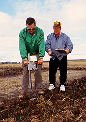 Soil scientists use a recording penetrometer to collect soil strength measurements. Click here for full photo caption.
