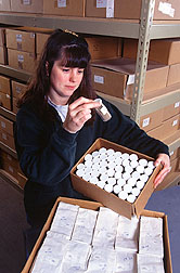 A biological science technician catalogs and archives soil samples. Click here for full photo caption.