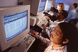 DNA analysis software aids examination of DNA sequence and fragment-size data. Click here for full photo caption.