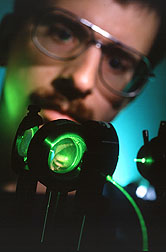 Chemist measures the blue fluorescence of aflatoxin or fumonisin in corn. Click here for full photo caption.
