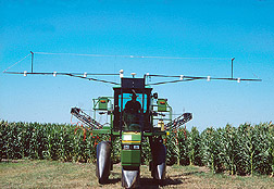 Mounted on a high-clearance sprayer,crop canopy sensors monitor plant greenness. Click here for full photo caption.