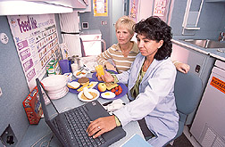 Nutritionist and psychology technician enter information into a database: Click here for full photo caption.