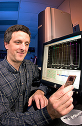 Geneticist holding a chip: Click here for full photo caption.
