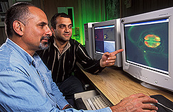 Research leader and Ph.D. student look at a digital image: Click here for full photo caption.