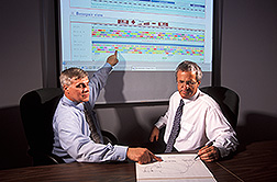Two molecular biologists use gene sequences and genomic sequence: Click here for full photo caption.