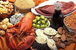 Shown are foods rich in copper: nuts, sunflower seeds, lobster, green olives, wheat bran, liver, blackstrap molasses, cocoa, oysters and black pepper. Link to photo information