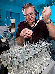 Soil scientist prepares for analysis of water samples from a municipal park being irrigated with reclaimed water: Click here for full photo caption.