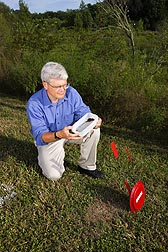 Entomologist prepares to release several hundred fire ant workers parasitized by a new phorid fly species (Pseudacteon cultellatus) that prefers to attack the smallest fire ant workers: Click here for full photo caption.