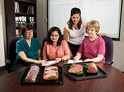 Nutrient Data Laboratory scientists review the revised USDA nutrient data sets for fresh pork and beef: Click here for full photo caption.