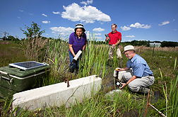 Graduate assistant Traci Hudson (left) and ARS soil scientist Martin Locke (center) measure water quality while professor Jerry Farris collects another water sample for analysis: Click here for full photo caption.