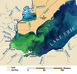 Photo: A satellite image of Lake Erie from September 2011, overlaid on a map of the lake and its tributaries showing an algal bloom in green. Link to photo information