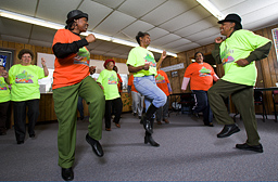Photo: A group of elderly women participating in an aerobic exercise class.  Link to photo information